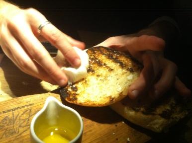 rubbing on the garlic